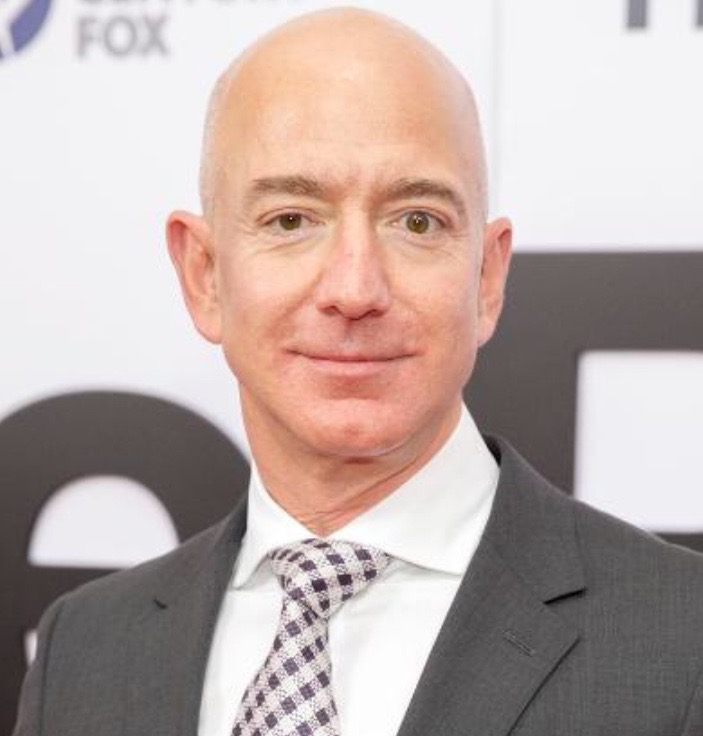 A photo of Jeff Bezos whose net worth is over a billion dollars.