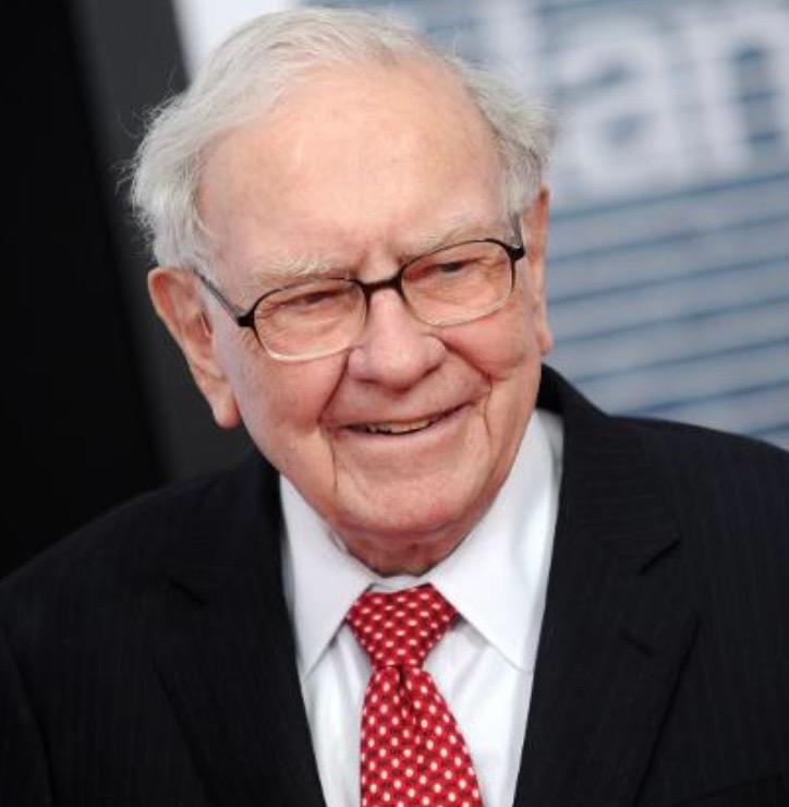 A photo of Warren Buffett whose net worth is over a billion dollars.